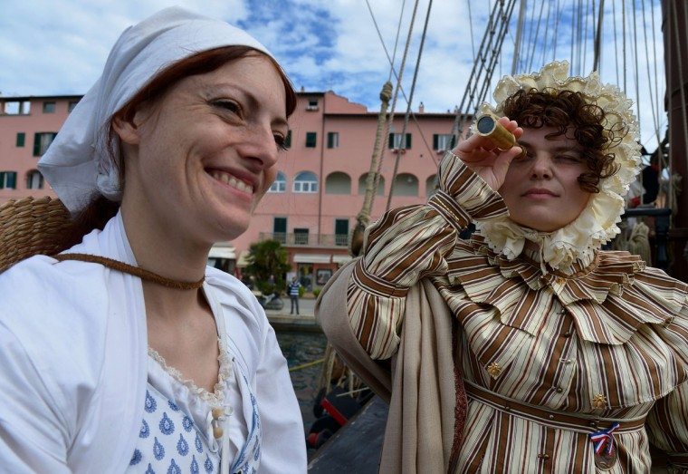 "People dressed as part of the Napoleonic era take part in a reconstruction aboard ""The Grace"", an old frigate, on May 4, 2014, in the harbor of Portoferraio on the Italian island of Elba. (VINCENZO PINTO/AFP/Getty Images)"