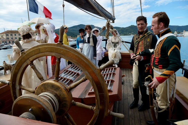"People dressed as part of the Napoleonic era take part in a reconstruction onboard ""The Grace"", an old frigate, on May 4, 2014, in the harbor of Portoferraio on the Italian island of Elba. (VINCENZO PINTO/AFP/Getty Images)"