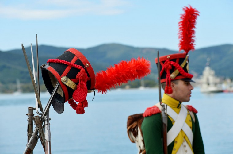 A man dressed as a Napoleonian soldier stands on May 4, 2014, in the harbor of Portoferraio on the Italian island of Elba. (VINCENZO PINTO/AFP/Getty Images)