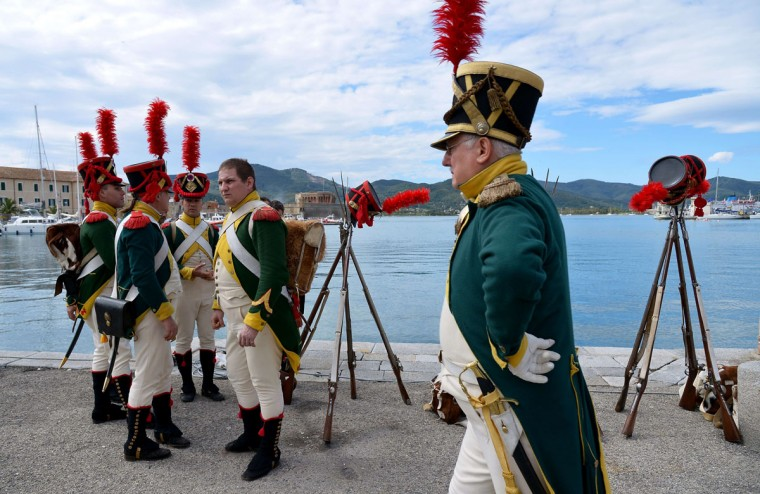 People dressed as Napoleonian soldiers perform May 4, 2014, in the harbor of Portoferraio on the Italian island of Elba. (VINCENZO PINTO/AFP/Getty Images)