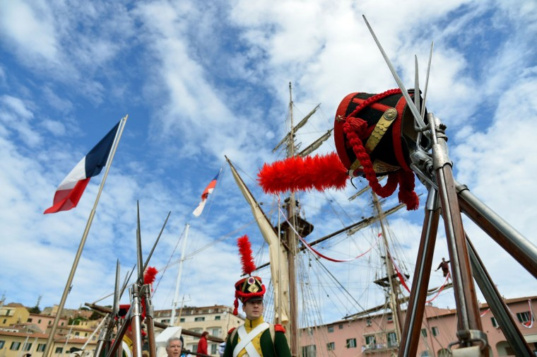 People dressed as Napoleonian soldiers perform on May 4, 2014, in the harbor of Portoferraio on the Italian island of Elba. (VINCENZO PINTO/AFP/Getty Images)