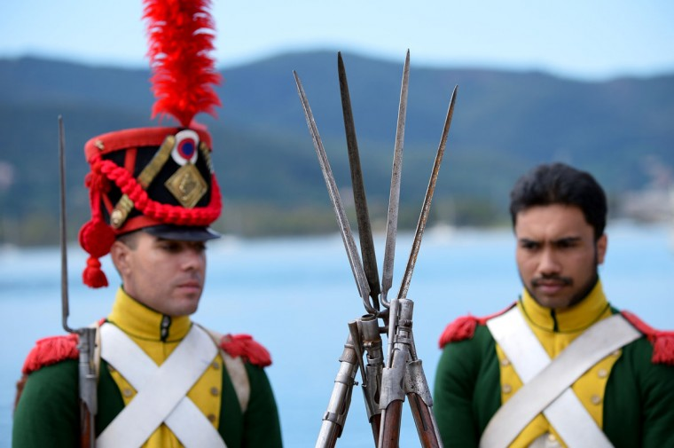 People dressed as Napoleonian soldiers stand on May 4, 2014, in the harbor of Portoferraio on the Italian island of Elba. (VINCENZO PINTO/AFP/Getty Images)