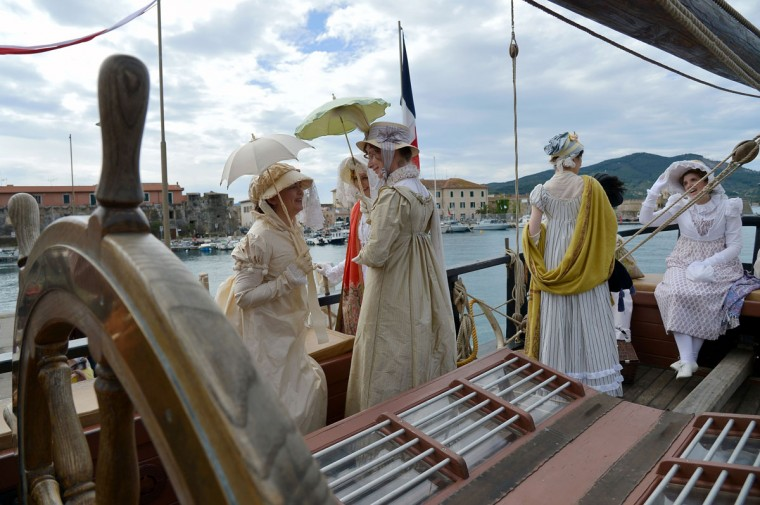 "People dressed in Napoleonic era costumes take part in a re-enactment aboard ""The Grace"", on May 4, 2014, in the harbor of Portoferraio on the Italian island of Elba. (VINCENZO PINTO/AFP/Getty Images)"