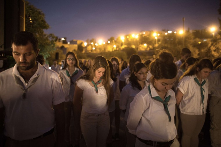 Israeli scouts observe a two minute silence as a siren is heard across the country at the start of Remembrance Day on May 4 2014, in Jerusalem to commemorate 23169 fallen Israeli soldiers killed since 1860 including civilians killed in hostile actions since 1948. Remembrance Day is followed immediately by the 66th anniversary of the creation of Israel in 1948 according to the Jewish calendar. (Menahem Kahana/AFP/Getty Images)