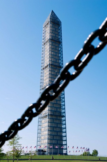 In this Ocober 1, 2013 file photo, the Washington Monument is seen behind a chain fence in Washington, DC. The Washington Monument, one of the US capital's most recognizable sights, was to reopen May 12, 2014, three years after sustaining damage from a rare earthquake. (KAREN BLEIER/AFP/Getty Images)
