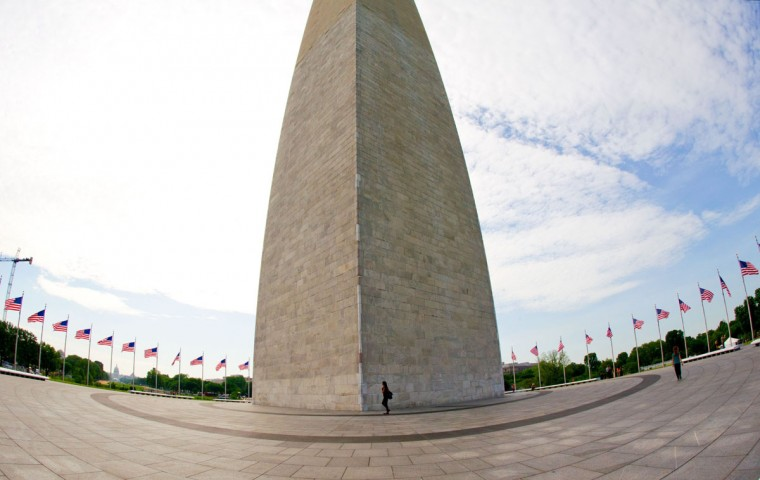 A person walks across the plaza at the Washington Monument May 12, 2014 in Washington, DC. (KAREN BLEIER/AFP/Getty Images)