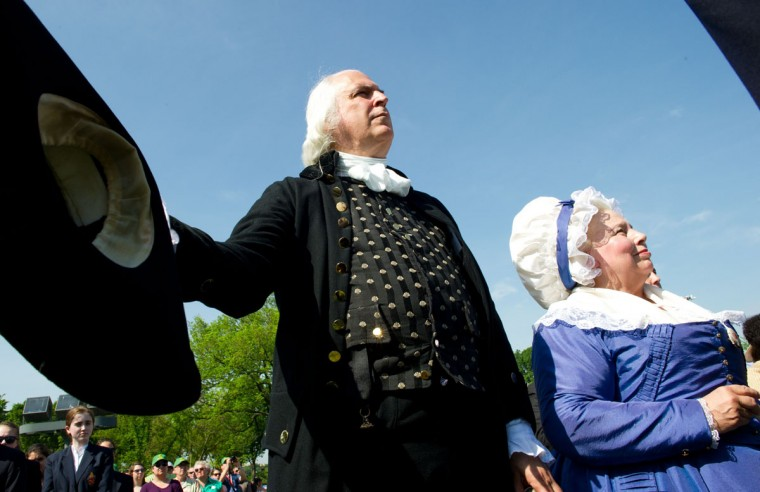 Reenactors portraying first US President George Washington and his wife Martha, stand for the National Anthem May 12, 2014 during re-opening ceremonies at the Washington Monument. (KAREN BLEIER/AFP/Getty Images)