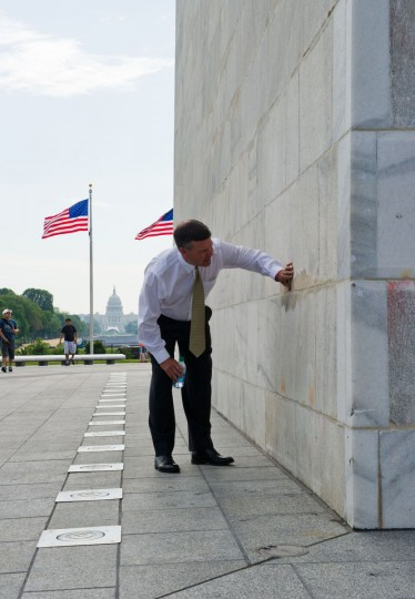 A man inspects some of the freshly completed mortar work done to the Washington Monument. (KAREN BLEIER/AFP/Getty Images)