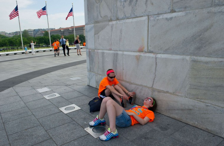 School girls sit at the base of the Washington Monument. (KAREN BLEIER/AFP/Getty Images)