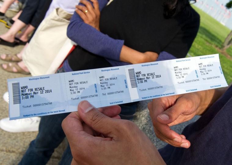 A tourist holds a ticket to tour the Washington Monument. (KAREN BLEIER/AFP/Getty Images)