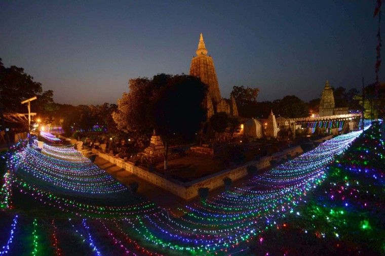 A World Heritage site, the Mahabodhi Temple is illuminated with lights on the occassion of the 2558th Buddha Jayanti celebrations at Bodhgaya on May 12, 2014. Buddha Jayanti, the most sacred Buddhist festival, celebrates the birthday of Lord Buddha and commemorates his enlightenment and death. It is held on a full moon in May each year and in 2014, Buddha Jayanti falls on May 14. (AFP/Getty Images)