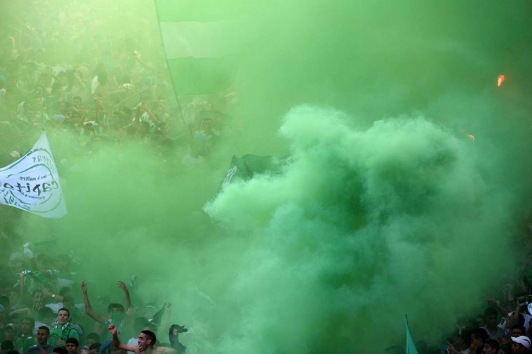 Raja Club Atletic's supporters watch the game in a green smoke during the match against Moghreb Athletic of Tetouan on May 19, 2014 in Casablanca. Raja Club Atletic won the match 5-0. (Fadel Senna/AFP/Getty Images)