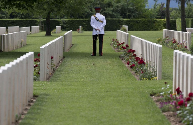 Britain's Prince Harry visits the Cassino's Commonwealth War Cemetery at the end of a ceremony on the occasion of the 70th anniversary of the WWII's Monte Cassino battle, on May 19, 2014. (Alessandra Tarantino/AFP/Getty Images)