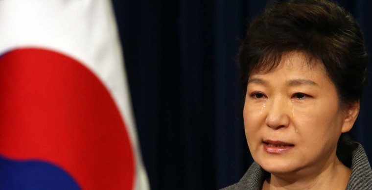South Korea's President Park Geun-Hye weeps as she makes a televised address to the nation from the presidential Blue House in Seoul on May 19, 2014. Park took tearful responsibility for the mishandling of last month's Sewol ferry disaster, admitting that many lives were lost through incompetence and a lack of preparedness. Yonhap/AFP/Getty Images)