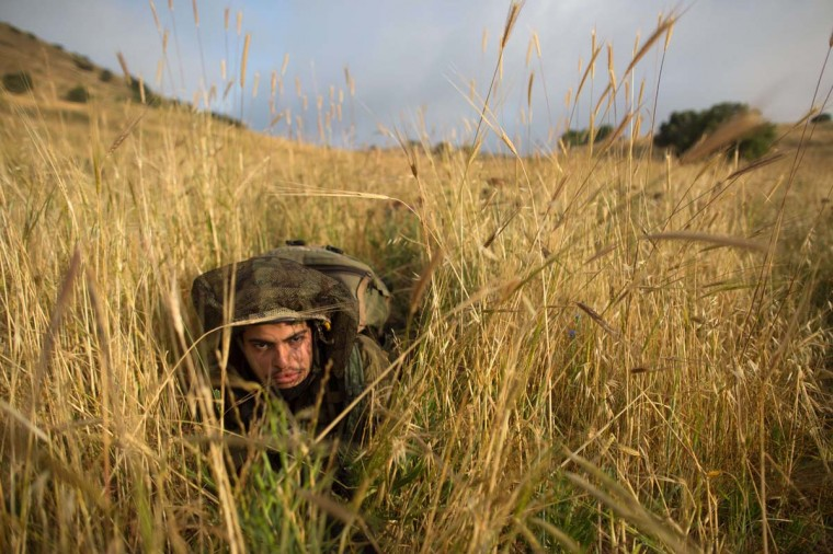 "Israeli soldiers of the Ultra-Orthodox battalion ""Netzah Yehuda"" take part in their annual unit training in the Israeli annexed Golan Heights, near the Syrian border on May 19, 2014. The Netzah Yehuda Battalion is a battalion in the Kfir Brigade of the Israel military which was created to allow religious Israelis to serve in the army in an atmosphere respecting their religious convictions. (Menahem Kahana/AFP/Getty Images/Reuters)"