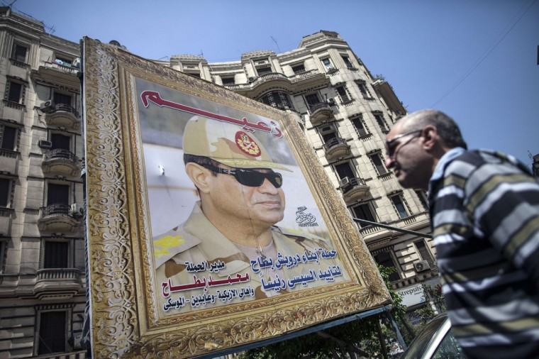 A poster of Egyptian ex-army chief and leading presidential candidate Abdel Fattah al-Sisi stand near a building in central Cairo on May 26, 2014. Egyptians begin voting in a new presidential election which ex-army chief Abdel Fattah al-Sisi, who ousted the elected Islamist leader, is expected to easily win amid calls for stability and economic recovery. (Mahmoud Khaled/AFP/Getty Images)
