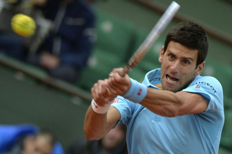 Serbia's Novak Djokovic hits a return to Portugal's Joao Sousa during their French tennis Open first round match at the Roland Garros stadium in Paris on May 26, 2014. (Miguel Medina/AFP/Getty Images)