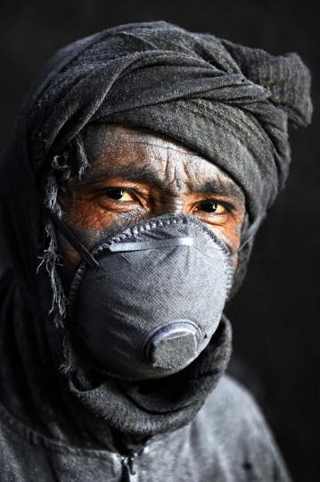 An Afghan labourer poses at an aluminium workshop in Herat on May 27, 2014. Some 100 people work in the Herat Aluminim factory with around around 70 to 100 tons of aluminum produced each month, with most all of its products used domestically. (Aref Karmia/AFP/Getty Images)