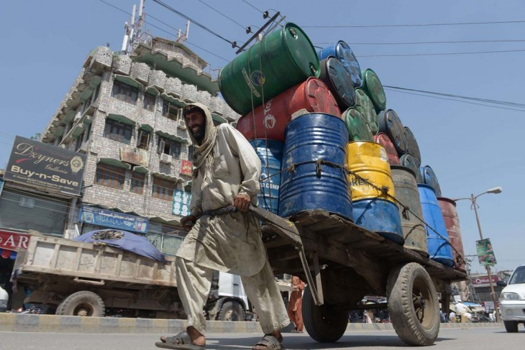 A Pakistani labourer pulls his cart loaded with barrels in Rawalpindi on May 27, 2014. Pakistan Finance Minister Senator Ishaq Dar said that the federal government would present its budget for the financial year 2014-15 on June 3. (Farooq Naeem/AFP/Getty Images )