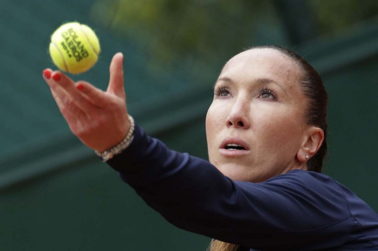 Serbia's Jelena Jankovic serves to Canada's Sharon Fichman during their French tennis Open first round match at the Roland Garros stadium in Paris on May 27, 2014. (Kenzo Tribouillard/AFP/Getty Images)