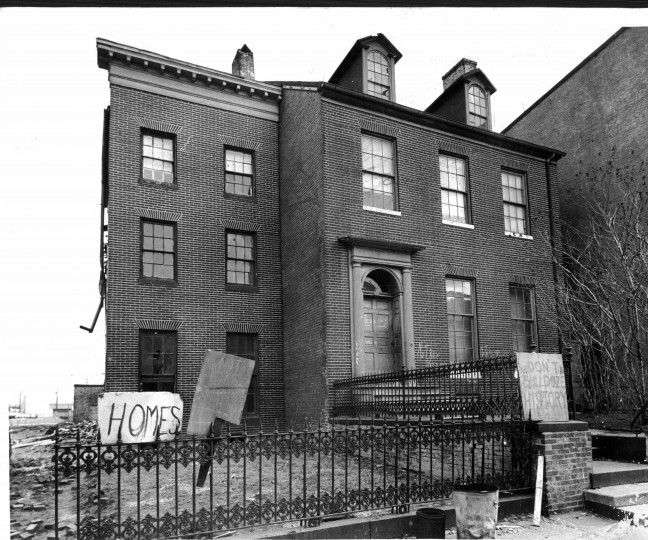 Neighborhood residents placed a sign in protest of the destruction of the house at 615 Washington Blvd., circa 1795; now a prime gas station site. (Baltimore Sun file)