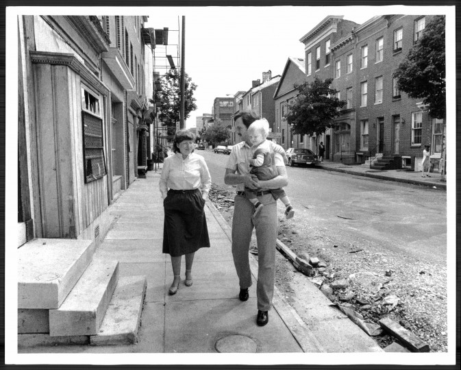 Renovators Giny and Keats Pullen walk with son Christopher near their home in the 600 block of Washington Boulevard. (Lloyd Pearson/Baltimore Sun file/June 7, 1982)