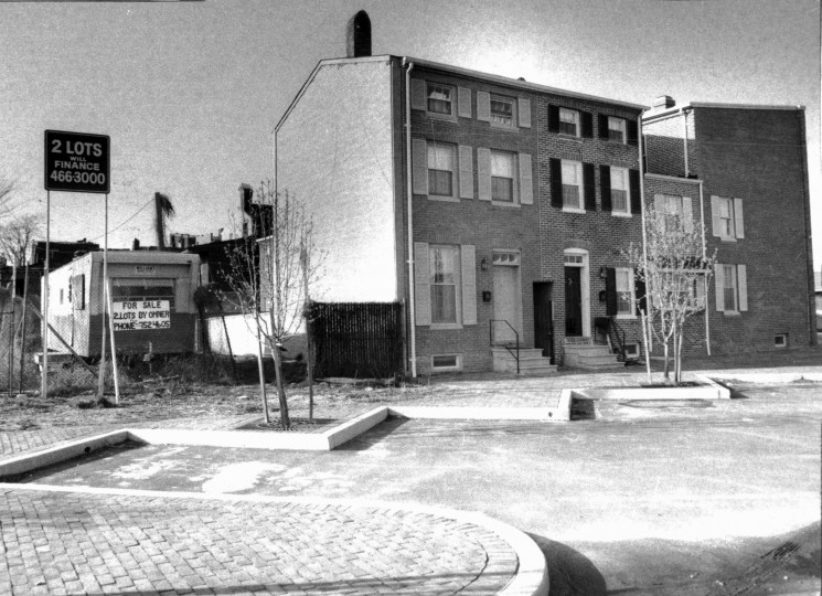 """Two vacant lots at 604 and 606 West Conway street in the renovation district of Ridgely's Delight were sold by the city to a developer for $100 each with a signed agreement that he would build 2 new houses on the lots. But, finding them """"too expensive"""" to develop, sold them for $2,000 to an investor who then had them for sale for a total of $30,000. (Baltimore Sun file/April 7, 1980)"""