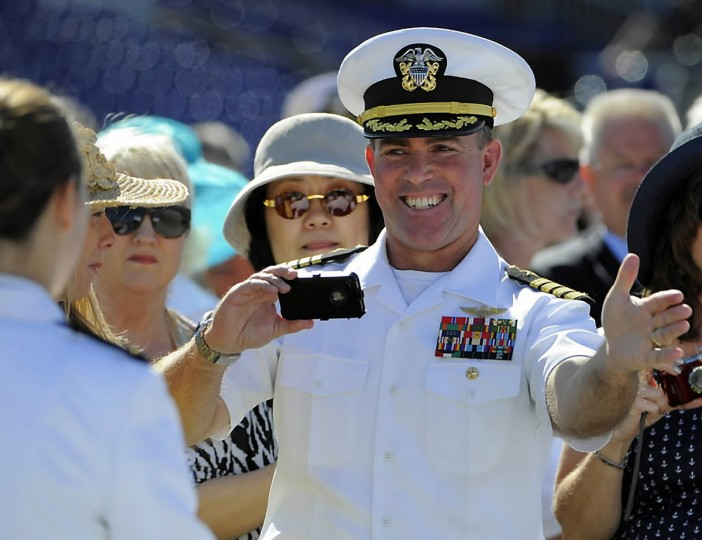 Captain Paul Lluy takes pictures of his son Ryan Lluy who is graduating today. The Lluy family were part of the 30,000 spectators on hand to watch the commissioning ceremony. Lloyd Fox/Baltimore Sun