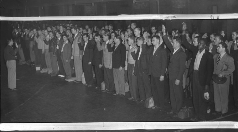 V.E. Day: Baltimore May 1945, draftees being sworn in on V.E. Day. (Baltimore Examiner and Washington Examiner)