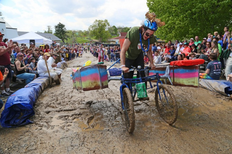 The annual Kinetic Sculpture Race kicked off this year starting at the American Visionary Art Museum and wound its way through Federal Hill, the Inner Harbor, Canton and Patterson Park. A cyclist makes it through one of the most difficult obstacles, the Patterson Park mud pit. (Kaitlin Newman/Baltimore Sun)