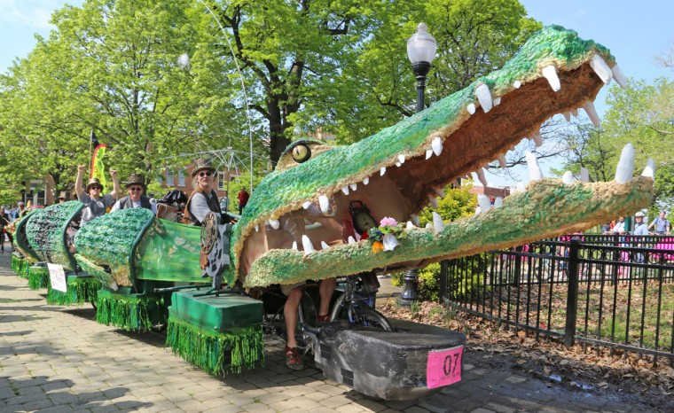 "The annual Kinetic Sculpture Race kicked off this year starting at the American Visionary Art Museum and wound its way through Federal Hill, the Inner Harbor, Canton and Patterson Park. ""Tic Toc the Croc"" rounds the bend. (Kaitlin Newman/Baltimore Sun)"