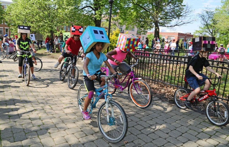 The annual Kinetic Sculpture Race kicked off this year starting at the American Visionary Art Museum and wound its way through Federal Hill, the Inner Harbor, Canton and Patterson Park. Team Minecraft cycled around the bend. Kaitlin Newman/Baltimore Sun)