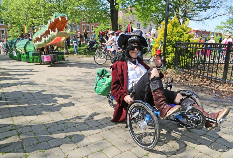 "The annual Kinetic Sculpture Race kicked off this year starting at the American Visionary Art Museum and wound its way through Federal Hill, the Inner Harbor, Canton and Patterson Park. ""Tic Toc the Croc"" rounds the bend with a pirate leading the way. (Kaitlin Newman/Baltimore Sun)"
