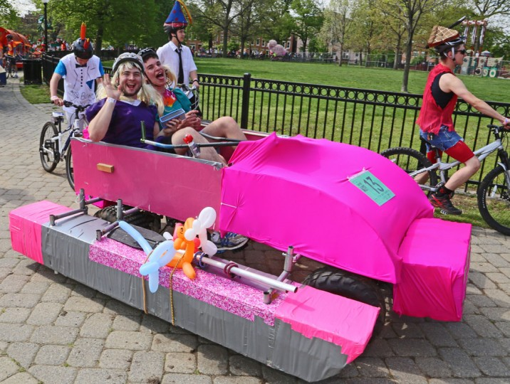 "The annual Kinetic Sculpture Race kicked off this year starting at the American Visionary Art Museum and wound its way through Federal Hill, the Inner Harbor, Canton and Patterson Park. ""Daddy's Beemer"" caught attention with its hot pink paint job and hot blondes behind the wheel. (Kaitlin Newman/Baltimore Sun)"