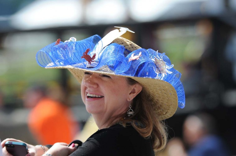 First-time grandstander, Karen Rund, from Finksburg, Md. is sporting a Cheseapeake Bay themed hat made by her sister. (Kim Hairston / Baltimore Sun)