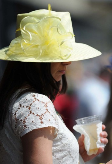 Jennifer Ziegler, from Philadelphia, Penn. chose a yellow hat for her first Preakness, as a not to the state flower. (Kim Hairston / Baltimore Sun)