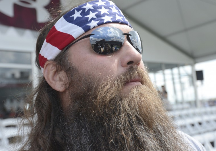 """Duck Dynasty"" star Willie Robertson takes in the scene at Preakness Viliage. (Kim Hairston/Baltimore Sun)"