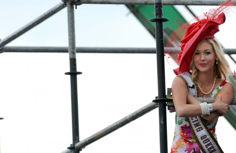 Standing on infield scaffolding, Ms. Racing Queen, Linsey Toole. (Kim Hairston,/Baltimore Sun)