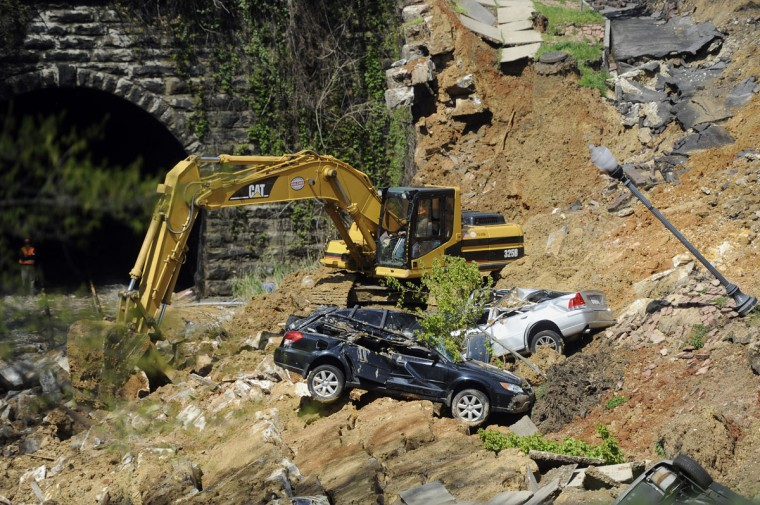 This is the scene of the aftermath of a landslide which occurred yesterday on 26th street between St. Paul and Charles Streets. Crews are on the scene removing debris and vehicles from the site. (Barbara Haddock Taylor/Baltimore Sun)