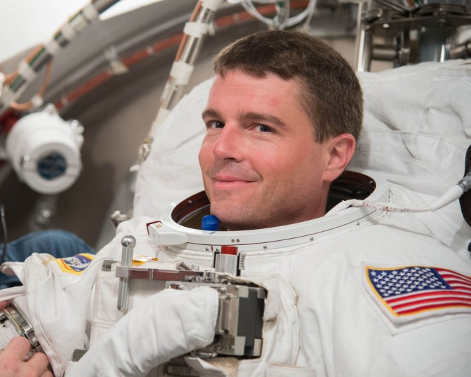 NASA astronaut Reid Wiseman, Expedition 40/41 flight engineer, participates in an Extravehicular Mobility Unit (EMU) spacesuit fit check in the Space Station Airlock Test Article (SSATA) of the Crew Systems Laboratory at NASA's Johnson Space Center. (NASA)