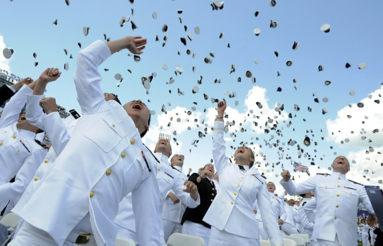 Midshipmen toss their hats into the air during the ceremonial hat toss to end the graduation ceremonies. Lloyd Fox/Baltimore Sun