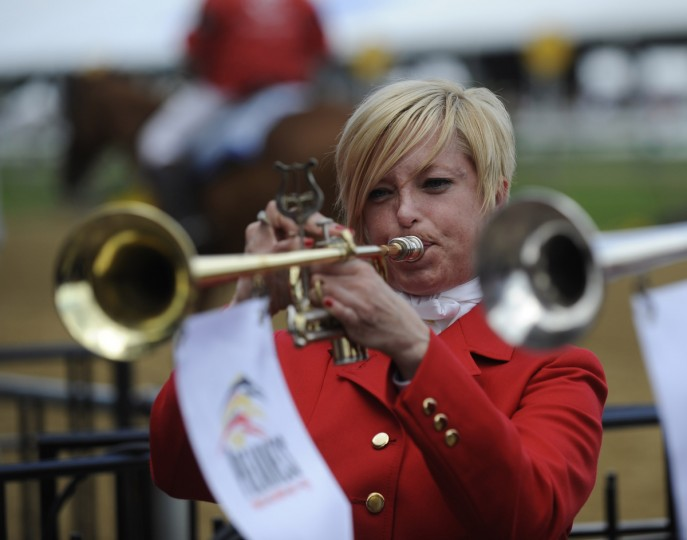 Bethann Dixon plays the Call to Post prior to the eighth race of the day. She is the first female bugler to play at the Preakness. (Jerry Jackson/Baltimore Sun)