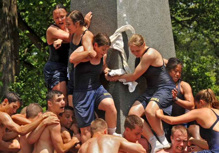 Female plebes form the top tier as they help wipe the vegetable shortening off the monument.The Herndon Monument Climb, the culmination of plebe year at the U.S. Naval Academy, was completed in 2:19:35 this year. (Amy Davis Baltimore Sun)