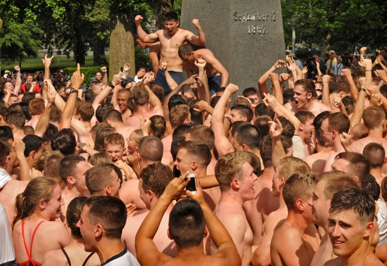 Jubilation reigns at the U.S. Naval Academy at the completion of the Herndon Monument Climb. This year's time was 2:19:35. The fastest time, without grease, was 1 minute, 30 seconds, and the slowest time was 4:05:17. (Amy Davis Baltimore Sun)