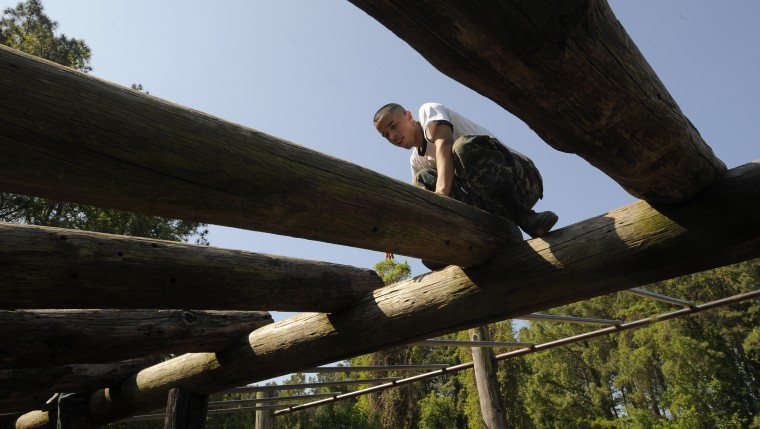 Midshipman Luis Pedrazacolon from San Juan, Puerto Rico balances on part of the obstacle course. The United States Navy held its Sea Trials today, a 14-hour Navy and Marine Corps-related team challenge that includes water tactics, an obstacle course, a two-mile run, pugil stick jousting, and several other survival skills. (Photo by Algerina Perna/Baltimore Sun)