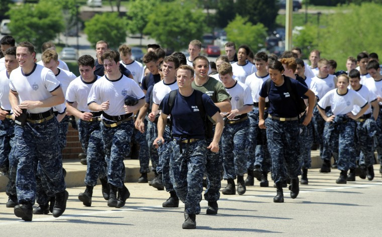 Midshipmen cross the bridge as part of the two-mile regimental run. The United States Navy held its Sea Trials today, a 14-hour Navy and Marine Corps-related team challenge that includes water tactics, an obstacle course, a two-mile run, pugil stick jousting, and several other survival skills. (Photo by Algerina Perna/Baltimore Sun)
