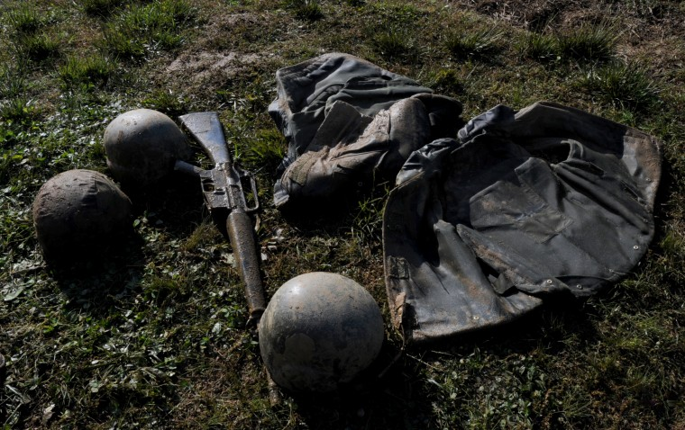 Muddy gear lies on the ground waiting for the next group of plebes to use. The United States Navy held its Sea Trials today, a 14-hour Navy and Marine Corps-related team challenge that includes water tactics, an obstacle course, a two-mile run, pugil stick jousting, and several other survival skills. (Photo by Algerina Perna/Baltimore Sun)