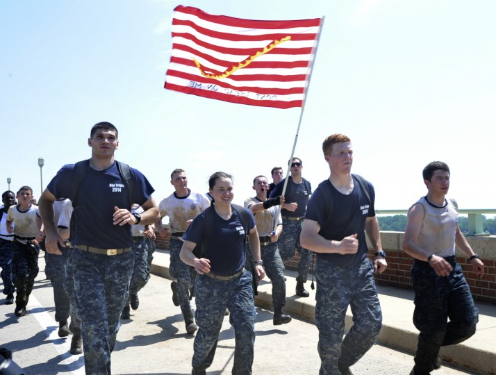 Midshipmen cross the Naval Academy bridge during the Sea Trials. The United States Navy held its Sea Trials today, a 14-hour Navy and Marine Corps-related team challenge that includes water tactics, an obstacle course, a two-mile run, pugil stick jousting, and several other survival skills. (Photo by Algerina Perna/Baltimore Sun)