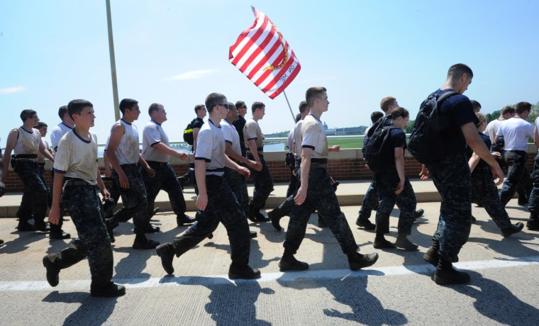 Midshipmen cross the bridge during the sea trials. The United States Navy held its Sea Trials today, a 14-hour Navy and Marine Corps-related team challenge that includes water tactics, an obstacle course, a two-mile run, pugil stick jousting, and several other survival skills. (Photo by Algerina Perna/Baltimore Sun)