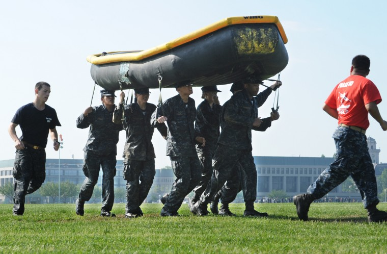 Plebes carry a Zodiac as part of the drills during the Sea Trials. The United States Navy held its Sea Trials today, a 14-hour Navy and Marine Corps-related team challenge that includes water tactics, an obstacle course, a two-mile run, pugil stick jousting, and several other survival skills. (Photo by Algerina Perna/Baltimore Sun)